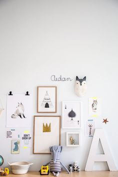 Love this kids gallery wall and the clips and washi tape holding some pieces.