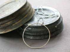 simple #circlenecklace by metamorph on Etsy, $55.00.  It's simple, yet just beautiful!