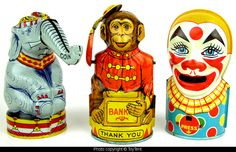 https://flic.kr/p/yD5LpB | Circus coin banks | Three vintage mechanical banks with circus theme made by J. Chein & Co.  Circus elephant eats coins like peanuts, monkey tips his hat, clown sticks out his tongue and devours the cash.