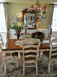 french country dining room with mustard / gold / yellow walls and
