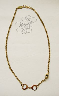 Gold Mini Handcuff And Skull Necklace by whoretothecore on Etsy