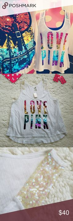 Victoria's Secret PINK Rainbow Bling Tank Top Flaw Victorias Secret PINK Rainbow Bling High Low Tank Top  Size small Brand new with tag nwt   Beautiful sequins Fashion show release Love Pink logo in rainbow pattern Flaws are 3 spots of discoloration, pilling on the back, & faint discoloration on the back I purchased it from the store this way; it's new with tag as you can see Please zoom in on pictures to see these details If you need more photos of something or more info, just ask…