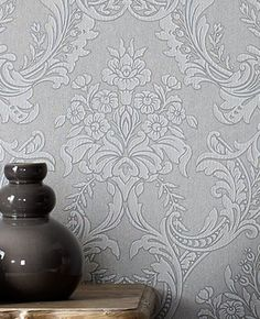 Metallic silver swirls on a medium charcoal gray wallcovering