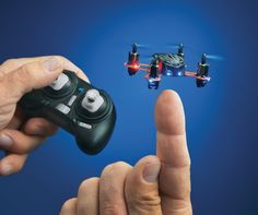 (Nano R/C Quadcopter) Buy Here: http://www.amazon.com/gp/product/B00G924W98/ref=as_li_qf_sp_asin_il_tl?ie=UTF8&camp=1789&creative=9325&creativeASIN=B00G924W98&linkCode=as2&tag=techzoid-20&linkId=4OUYY7TC26UXAVYM The world's smallest radio controlled quadcopter! Ready-to-fly straight from the box, has LED lights to indicate front and back, weighs only 11.5 grams, the built in LiPo battery charges via USB with a charge time of 10 minutes and the transmitter (controller) takes 2 AAA batteries.