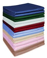 """Walmart sells flat twin bed sheets in individual packages (meaning without pillowcases and fitted sheets) for a whopping $2.00.  There is more than enough fabric to cover the typical bulletin board and they have a surprising assortment of colors."