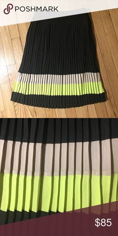 Ted Baker Accordion Skirt Cute accordion Ted Baker skirt that falls right below the knee. It's black, beige, and a little bit of neon yellow/green. It has a black underlay. I've received so many compliments on it! Zippers on the side with a hidden black zipper! Ted Baker London Skirts Midi