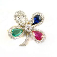 An extremely rare antique diamond and gem set four leaf clover brooch-pendant, c.1900, retailed by Cartier. Original box