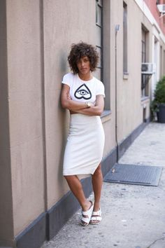 20 ways to Style Spring Pieces Now: Birkenstocks - white crop top t-shirt with a quirky eye graphic, styled with a white pencil skirt + matching white Birkenstocks