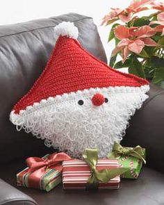 This little Santa pillow is sure to bring holiday cheer to any house he visits! Shown in Bernat Happy Holidays.
