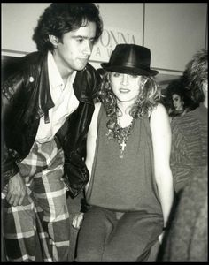 Andy Warhol candid snaps: JOHN 'JELLYBEAN' BENITEZ & MADONNA Jellybean Benitez and Madonna pose for this spontaneous Warhol photo. Benitez is known for producing and remixing songs for artists, especially Madonna.