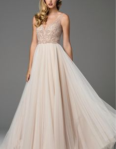 A stunning wedding gown for a day you will remember for the rest of your life, this romantic gown has a richly embellished bodice and voluminous skirt of blushing pink tulle.