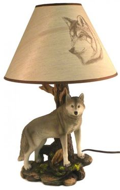 This Majestic Gray Wolf Lamp is the perfect accent for any room in your home or cabin. The base of this lamp features a sculptural representation of a gray wolf. Display this wolf lamp proudly or give