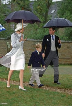Diana, Princess of Wales, Prince William and Prince Charles, at her brother's wedding at Althorp. The Princess is wearing suit designed by Catherine Walker.