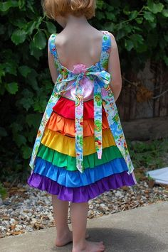 FELIZ. I got the pattern and Foo just asked for a rainbow dress. :) briggsgirl