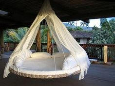 Yes please!! ... does it also transport back and forth to Bali??  Designer DIY Idea: Swinging Bed Made With a Recycled Trampoline