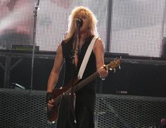 Rick Savage live with Def Leppard on August 13, 2008