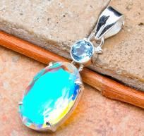 WELCOME TO CINDERELLA'S REVENGE  ~Very Cool Stuff at Even Cooler Prices for the Coolest People~  PLEASE READ EVERYTHING BELOW! THANKS! RETURN VISITORS PLEASE READ ITEM DESCRIPTION.  IT TRULY GLOWS! APPROXIMATELY 16 CTW RAINBOW MYSTIC TOPAZ PENDANT WI...