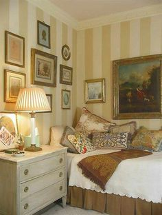 Pretty daybed and bedding, striped walls, art........ nice English style...always the best