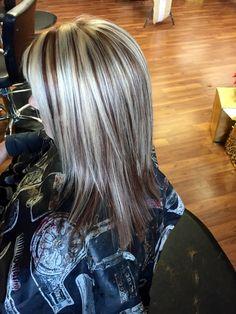 Hair by Heather. Mocha brown lowlights. Heavy blonde highlight.