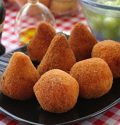 Italian Rice Balls (Arancini) | Rice balls are filled with ground beef and fried until golden brown. This is a great recipe for leftover rice.