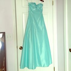 Jessica McClintock aqua strapless backless dress Gorgeous Cinderella aqua dress that will make you feel like a princess! Floor length, satin finish, 100% polyester. Only worn once to prom.  There are a few stains on the bottom of the dress that are not very apparent. Also the inside on top has black marks most likely from the dry cleaner ironing too furiously..but you can't see it when wearing. Jessica McClintock Dresses Strapless