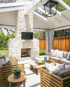 Cream Stone Outdoor Fireplace - Design photos, ideas and inspiration. Amazing gallery of interior design and decorating ideas of Cream Stone Outdoor Fireplace in bedrooms, decks/patios, pools by elite interior designers. Outdoor Rooms, Outdoor Decor, Outdoor Living Spaces, Outdoor Lighting, Indoor Outdoor Living, Outdoor Ideas, Open Space Living, Outside Living, House With Porch