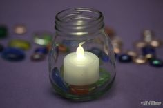 """Step 5: Turn the electric votive candle in the """"on"""" position and place inside.  Do this right away in order to get the most use from your votive candle."""