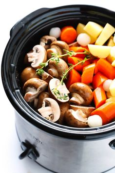 This Portobello Pot Roast recipe is easy to make in the slow cooker or pressure cooker (Instant Pot), it's full of tender potatoes, mushrooms, carrots, onions, garlic and a savory gravy, it's naturally gluten-free, vegetarian and vegan, and it's TOTALLY delicious! My kind of comfort food! | gimmesomeoven.com #potroast #vegetarian #vegan #glutenfree #mushroom #healthy #dinner #recipe