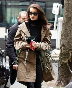 Bella Hadid wearing a large fringed trench coat