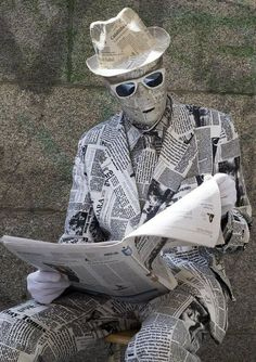 100% ART.  A man performs as the newspaper man living statue near the puerta del sol square in Madrid