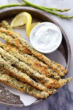 Asparagus that gets coated in a Parmesan Herb Panko and is baked to crispy and delicious perfection! The entire family ...