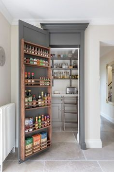 The walk in pantry at the Sevenoaks, Kent project is concealed behind a door finished in H|M Top Hat with spice racks to maximise food storage. #humphreymunson