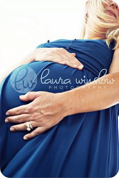 Like the emphasis on baby belly and wedding ring..