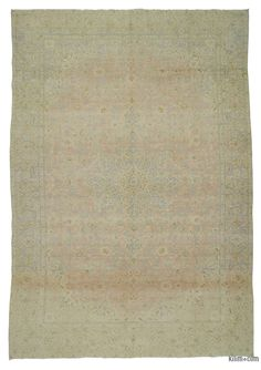 This over-dyed Persian vintage rug is a celebration of both past and present. Created using a technique employed to breathe new life into older hand-knotted rugs, the colors are first neutralized before the rug is over-dyed with its entirely new hue. The original pattern can still be traced, a tribute to the skilled weavers who created it. The quality of the rug shines through, yet the recycled rug now fits perfectly into a contemporary interior design. Consider it not just as a rug, but as…