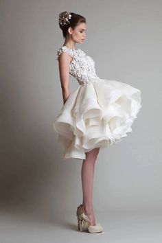 short and sweet. I usually don't like short wedding dresses but this is cute!