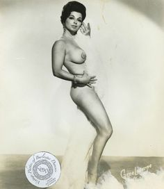 "Carmela (Rickman) - The Sophia Loren of Burlesk: vintage 8x10 photo Carmela was a divorced mother of two working as a waitress in Washington DC, when she decided to give burlesque a try.  Eventually she signed with Sol Goodman, who was also Blaze Starr agent and the owner of the 2 o'clock Club in Baltimore, MD.  Originally Carmela had danced under the moniker ""The Torrid Twister"", but Goodman suggested they capitalize on her resemblance to Sophia Loren.  Carmela was known for her muscle ..."