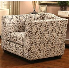 Accent your home with this upholstered chair. Features a solid wood construction for sturdy and heavy use. It is upholstered in an ikat pattern fabric, with beige, brown, and light teal colors, for supreme comfort and style.