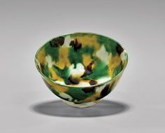 """Antique Chinese """"egg and spinach"""" splash-glazed porcelain bowl; the small round form set on a wide foot, showing much iridescence; probably Kangxi Period; D: 4 1/2"""""""
