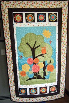 Owl in tree baby quilt. I wish I knew how to quilt. :(