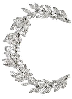 Diamond tiara/necklace, circa 1910. Designed as a graduated spray of myrtle leaves and berries, millegrain set with circular- and single-cut diamonds, to an earlier chain of similarly cut stones, length approximately 430mm, detachable tiara frame.