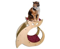 Cattino - Cat Scratcher, Kitty Condo & Cat Perch Pet Furniture with cat nip. $149.00, via Etsy. [I wonder if I can get this with custom fabric.]