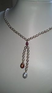 Classic Lariat necklace of golden pearls and 1 carat Genuine Ruby briolette.