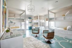 Two set sof bunk beds ihelp create this well-designed space, done by Tracy Hardenburg.  VT Interiors - Library of Inspirational Images