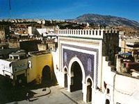 There are several gates allowing entry to the ancient town of  Fez: Bab Bou Jeloud, the western gate has bright decorations and  hotels and cafes grouped around it; Bab Er Rsif is the central  gate, opening onto the square in front of the mosque of the same  name; Bab el-Ftouh is the southeast gate giving onto the  cemeteries; and Bab Guissa, the north gate, lies on the hillside  close to the Merenid tombs vantage point.