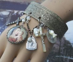 Cuff Charm bracelet. Charm bracelet made with vintage crosses, religious charms, catholic items,  altered art bracelet that makes a statement for recycled, repurposed and upcycled charms