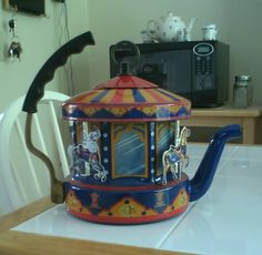 Dusty Old Thing - Carousel teapot - when water boils, it turns the horses.