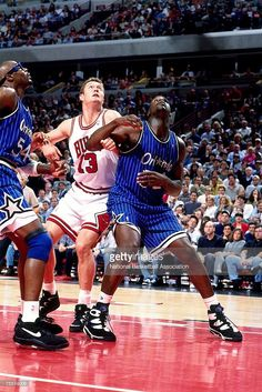 Shaquille O'Neal #32 of the Orlando Magic battles for position against Luc Longley #13 of the Chicago Bulls during Game Three of the 1995 Easter Conference Semi-Finals at the United Center on May 12, 1995 in Chicago, Illinois.