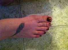 Pretty feather on my foot tattoo.