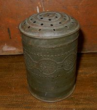 Early Embossed Tin Shaker
