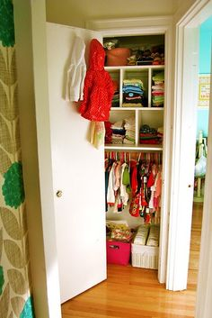 Kids don't need clothes hanging 5 feet off the ground.  Lower them so they can reach, and you can store stuff above.